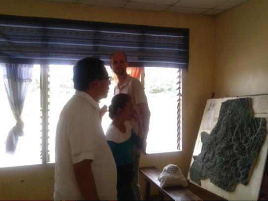 Fr. Joey Cruz, SJ,, Gail Ilagan, and Thomas Klompmaker examine the map of the Matigsalog ancestral domain.